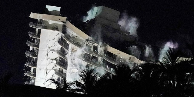 Demolition teams bring down the unstable remainder of the Champlain Towers South condo building, late Sunday, July 4, 2021, in Surfside, Florida. (Associated Press)