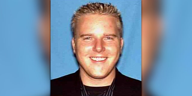 Michael Long is 6 feet, four inches tall, weighs about 205 pounds and has green eyes and blonde hair.
