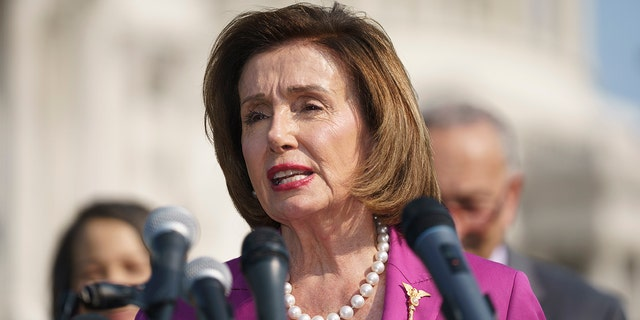 Speaker of the House Nancy Pelosi, D-Calif., talks at an event on the urgent need to counter climate change in the US with transformational investments in clean jobs, at the Capitol in Washington, Wednesday, July 28, 2021. (AP Photo/J. Scott Applewhite)