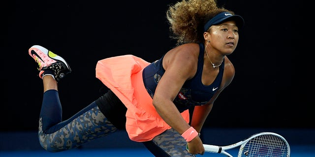 Japan's Naomi Osaka serves to the United States' Jennifer Brady during the women's singles final at the Australian Open tennis championship in Melbourne, Australia, in this Saturday, Feb. 20, 2021. (AP Photo/Andy Brownbill, File)