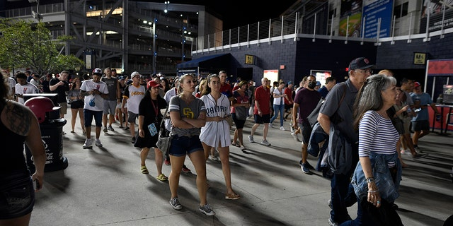 Spectators leave National Park after an incident near the ballpark during the sixth inning of a baseball game between the Washington Nationals and the San Diego Padres on Saturday, July 17, 2021 in Washington.  (The Associated Press)