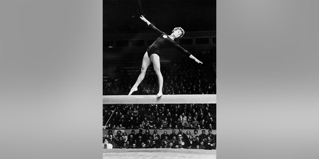 Soviet Olympic gymnast Larissa Latynina performed her routine on the balance beam during the Melbourne 1956 Olympic Games, which was held between November and, December that year. Latynina went on to win four gold medals in Melbourne.