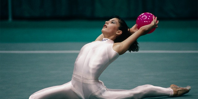Ukranian rhythmic gymnast Elena Vitrichenko performed her floor routine at the 1996 Olympic Games in a silver, sleeveless unitard. The outfit is not commonly seen in artistic gymnastics.