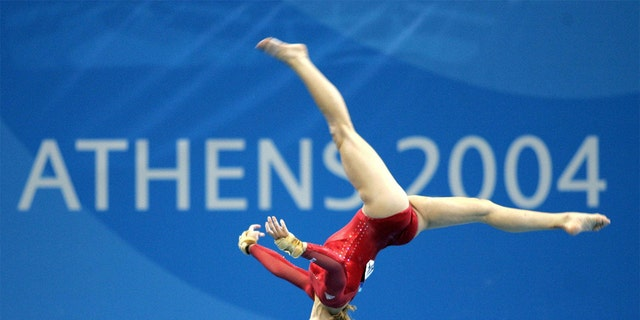 American gymnast Carly Patterson competed her way through the women's individual artistic gymnastics final in a vibrant red leotard at the Athens 2004 Summer Olympics.
