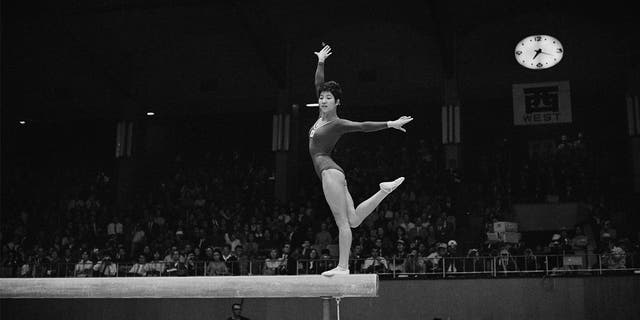 Japanese Olympic gymnast Chiba Ginko performed her routine on the balance beam during the women's artistic team all-around gymnastic competition on October 20, 1964, during the Tokyo 1964 Summer Olympics.