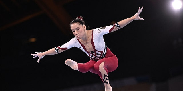 Germany's Kim Bui competed in the artistic gymnastics balance beam event for the women's qualifier during the Tokyo Summer 2020 Olympics. She performed her routine at the Ariake Gymnastics Centre in Tokyo on July 25, 2021.