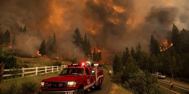 The rapidly growing wildfire jumped a highway, prompting more evacuation orders and the cancellation of an extreme bike ride through the Sierra Nevada.