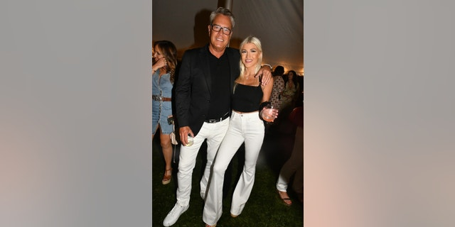 Peter Cook poses happily with his fiancée Alba Jancou at a 4th of July party in Southampton. The 62-year-old posed for cameras in matching black and white with his 21-year-old love. The couple got engaged two years ago in Greece, although it seems as if they have yet to get married.