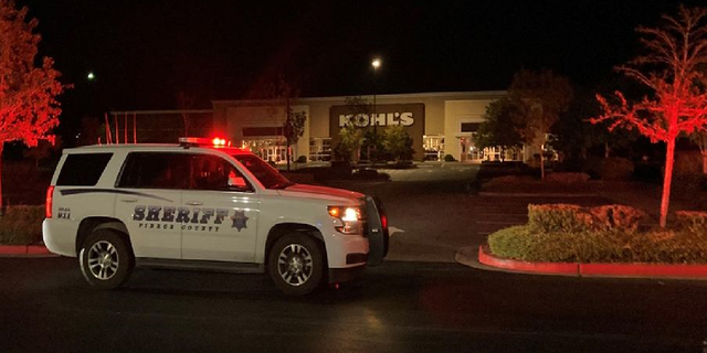 Police investigate the scene of a homicide at a Kohl's store in Puyallup, Wash., outside of Seattle. (Pierce County Sheriff's Department)