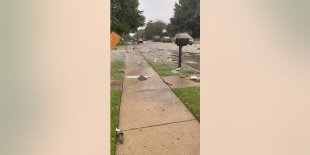 Debris litter a residential street in the Dallas suburbs of Plano after a reported explosion Monday.