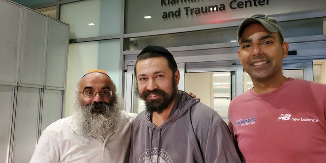 Rabbi Shlomo Noginski, middle, was released from the hospital on Thursday after being stabbed in the arm several times earlier in the day.