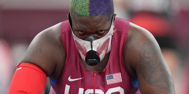 Raven Saunders of the United States rests during throws of the qualification rounds of the women's shot put at the 2020 Summer Olympics, Friday, July 30, 2021, in Tokyo. (AP Photo/Matthias Schrader)