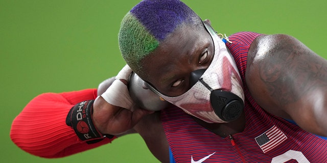 Raven Saunders of the United States competes in the qualification rounds of the women's shot put at the 2020 Summer Olympics, Friday, July 30, 2021, in Tokyo. (AP Photo/Matthias Schrader)