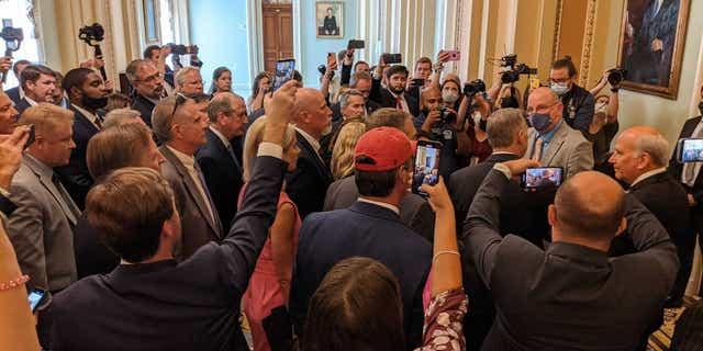 Republican congressmen protest the new House mask mandate