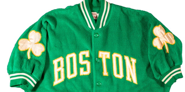 This photo provided by Hunt Auctions, shows a Boston Celtics NBA basketball jacket owned by Celtics player and coach, Bill Russell. (Mike Freeberg/Hunt Auctions via AP)