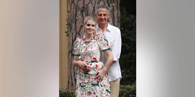 Newly married Princess Diana's niece Lady Kitty Spencer and her husband Michael Lewis pictured posing for a photo shoot at Villa Aurelia park in Rome on the day after their big wedding a lavish ceremony held at Villa Aldobrandini in Frascati.