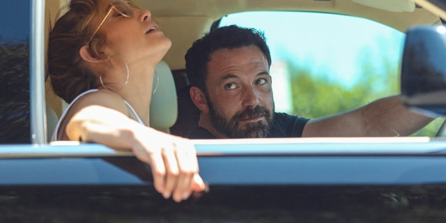 Ben Affleck adoringly stares at Jennifer Lopez while the two are stuck in Los Angeles traffic.