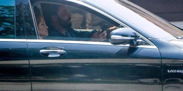 Ben Affleck and Jennifer Lopez took her kids Emme and Max to visit a house in Santa Monica on Friday. Lopez looked busy on the phone while Ben drove the car while house hunting.