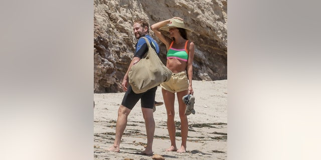 Gerard Butler and Morgan Brown enjoyed a beach day with friends in Malibu, Calif.