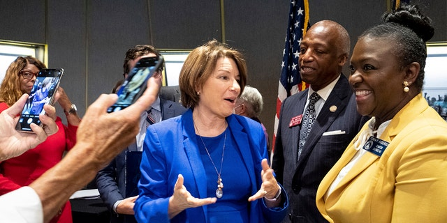 Sen. Amy Klobuchar, center, D-Minn., talks with Georgia State Legislators following a Senate Rules Committee field hearing on voting rights at the National Center for Civil and Human Rights in Atlanta, Monday, July 19, 2021. (AP Photo/Ben Gray)