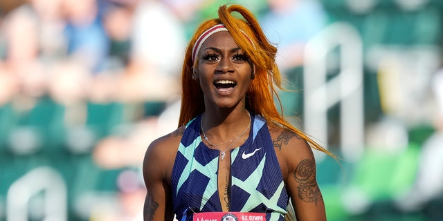 In this June 19, 2021 photo, Sha'Carri Richardson celebrates after winning the first heat of the semis finals in women's 100-meter runat the U.S. Olympic Track and Field Trials in Eugene, Ore. Richardson cannot run in the Olympic 100-meter race after testing positive for a chemical found in marijuana.
