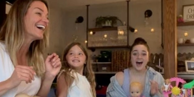 """Babysitter Delaney Wilson (right) went viral after her boss Nicki Maher (left) posted a video of Wilson singing the Disney song """"Part of your world"""" on his TikTok page."""