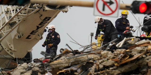 Search and rescue personnel work atop the rubble at the Champlain Towers South condo building on Wednesday. (AP)