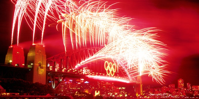 The Sydney Harbour Bridge is lit up with fireworks after the Closing Ceremony of the Sydney 2000 Olympic Games in Sydney, Australia. (Matt Turner/ALLSPORT)