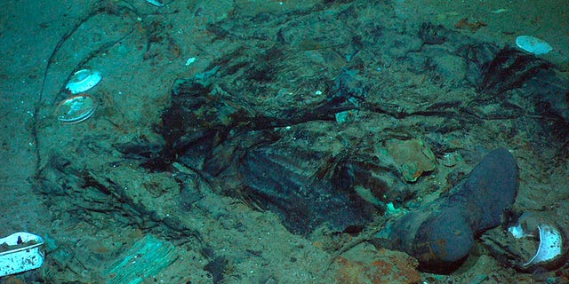 This 2004 photo provided by the Institute for Exploration, Center for Archaeological Oceanography/University of Rhode Island/NOAA Office of Ocean Exploration, shows the remains of a coat and boots in the mud on the sea bed near the Titanic's stern. (Institute for Exploration, Center for Archaeological Oceanography/University of Rhode Island/NOAA Office of Ocean Exploration)