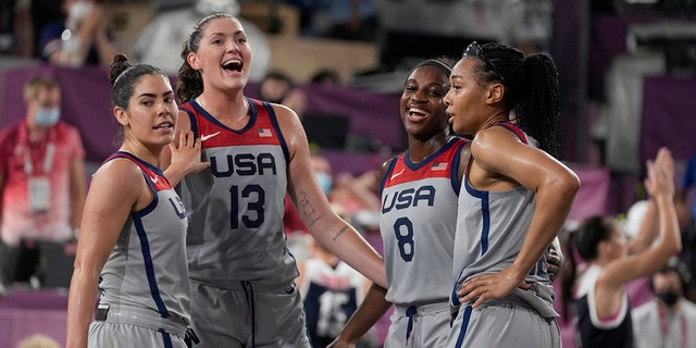 U.S. players Kelsey Plum, left, Stefanie Dolson (13), Jacquelyn Young (8) and Allisha Gray celebrate after defeating Russian Olympic Committee in a women's 3-on-3 gold medal basketball game at the 2020 Summer Olympics, Wednesday, July 28, 2021, in Tokyo. (Associated Press)