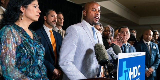 Democratic Texas State Rep. Ron Reynolds from Missouri City, center, together with fellow Texas legislators, speaks during a news conference, Wednesday, July 14, 2021, in Washington.