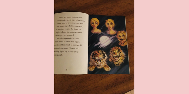 A book showing a killer tiger formed from a White woman.