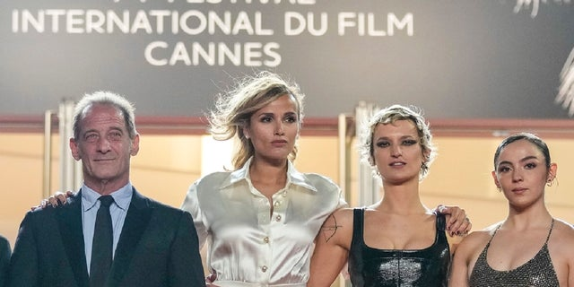Vincent Lindon, from left, director Julia Ducournau, Agathe Rousselle, Garance Marillier and Lais Salameh pose for photographers upon arrival at the premiere of the film 'Titane' at the 74th international film festival, Cannes, southern France, Tuesday, July 13, 2021. (AP)