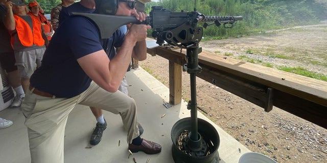 Republican Sen. Tom Cotton of Arkansas fires a machine gun at the third annual Hillsborough County, New Hampshire GOP machine gun shoot event and fundraiser, on July 17, 2021.