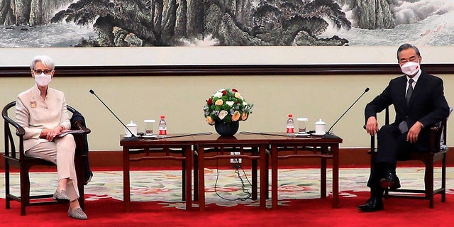 In this photo provided by the U.S. Department of State, U.S. Deputy Secretary of State Wendy Sherman, left, and Chinese Foreign Minister Wang Yi sit together in Tianjin, China, Monday, July 26, 2021. (U.S. Department of State via AP)