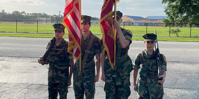 The Young Marines of the Palm Beaches celebrating Peter V. Ruvolo's birthday.