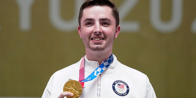 William Shaner, of the United States, holds his gold medal on after the men's 10-meter air rifle at the Asaka Shooting Range in the 2020 Summer Olympics, Sunday, July 25, 2021, in Tokyo. (Associated Press)