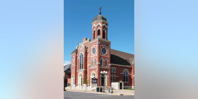 This June 2, 2021, photo provided by Marilyn J. Richmond shows St. James the Less parish in La Crosse, Wis. The Diocese of La Crosse said Friday, July 9, that Bishop William Patrick Callahan has removed the Rev. James Altman as pastor of St. James the Less effective immediately.