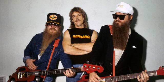 Dusty Hill, Frank Beard and Billy Gibbons - posed, group shot, backstage at Monsters Of Rock, Hot Rod shaped guitars, novelty guitars.