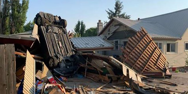 A car appeared to have been flipped into the Chelewah home.
