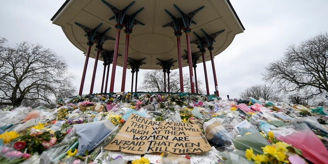 Flower greetings and messages are placed on the ribbon stand at Clapham Common in London in memory of Sarah Everard in March.  (AP)