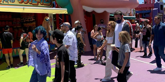 Jennifer Lopez and Ben Affleckwent to Universal Studios Hollywood with their children on Friday, July 2, 2021. Lopez's twins Max and Emma, 13, and Affleck's son Samuel, 9 were present during the family trip. (Credit: SWNS)