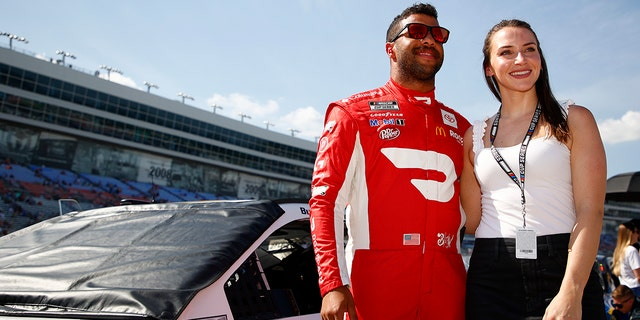 FORT WORTH, TEXAS - JUNE 13: Bubba Wallace, driver of the #23 Door Dash Toyota, poses for a photo on the grid with his girlfriend, Amanda Carter prior to the NASCAR All-Star Open at Texas Motor Speedway on June 13, 2021 in Fort Worth, Texas. (Photo by Jared C. Tilton/Getty Images)