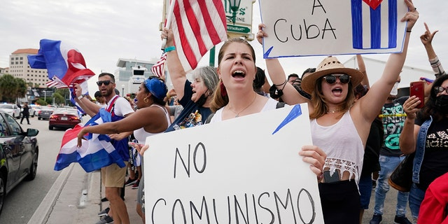 Cuban exiles rally at Versailles Restaurant in Miami's Little Havana neighborhood in support of protesters in Cuba on Monday in Miami. Sunday's protests in Cuba marked some of the biggest displays of antigovernment sentiment in the tightly controlled country in years. (AP Photo/Marta Lavandier)