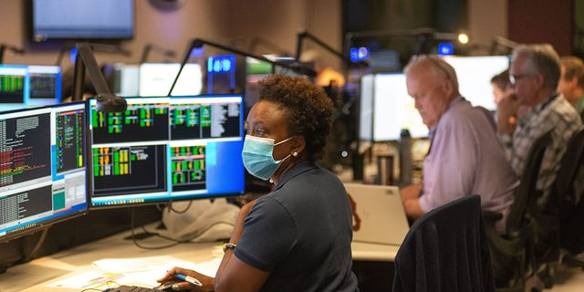 Nzinga Tull, Hubble systems anomaly response manager at NASA's Goddard Space Flight Center in Greenbelt, Maryland, works in the control room July 15 to restore Hubble to full science operations.