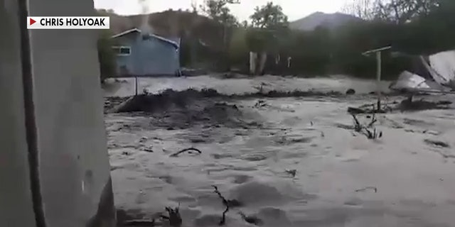 Globe resident Chris Holyoak captured the flash flood on his cellphone, sharing his footage with Fox News, showing the scary moments when a wall of water was barreling straight toward him. (Chris Holyoak)
