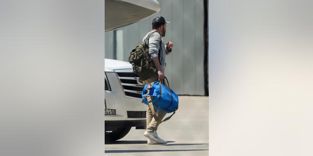 Ben Affleck returns from the Hamptons with Jennifer Lopez.