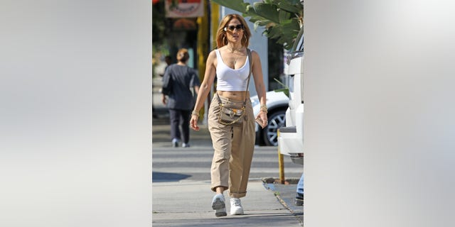 The musician showed off her toned abs with a white crop top.