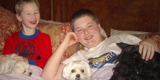 Simon, 5, and Seth, 12, and their dog Razzle.