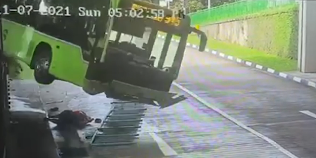 Driver narrowly escapes being crushed by falling bus